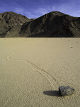 A sliding rock and it's track on the playa of Racetrack Valley, Death Valley National Park, California