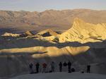 Photographers shoot dawn lighting on Zabriskie Point, Death Valley National Park, California