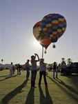 Tourists shoot balloons rising at the Havasu Balloon Fiesta