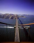 An Evergreen container ship passes under the Golden Gate Bridge into San Francisco Bay, California