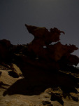 The eroded sandstone shapes of Devil's Fire come alive on a full moon night, Nevada