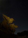 Orion hovers in the sky over the sandstone figures of Devil's Fire, Nevada