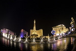 The fountains of Bellagio, Eiffel Tower in rear, Las Vegas, Nevada