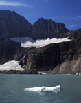 An iceberg floats in Upper Grinnell Lake, below the Salamander Glacier, Glacier National Park, Montana