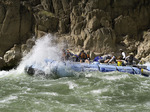 A motor rig hits a wave in Granite Rapid, Colorado River, Grand Canyon National Park, Arizona