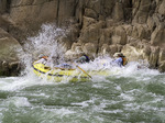 A paddle raft hits a wave in Granite Rapid, Colorado River, Grand Canyon National Park, Arizona
