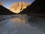 Sunrise light reflects off Chuar Butte on the Little Colorado River, Grand Canyon National Park, Arizona