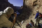 Photographers shoot sunrise light on the granaries of Nankoweap, Grand Canyon National Park, Arizona