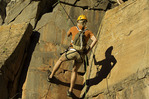 Rappelling down a sandstone wall in Benson Creek canyon, north of Cedar City, Utah