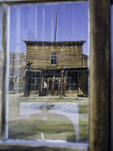 Summer afternoon reflected in vintage glass, Bodie State Historic Park, California