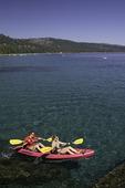 Friends kayak at D. L. Bliss State Park, Lake Tahoe, California