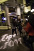 Girlfriends roam the Gaslamp District at night, San Diego, California