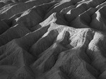 Morning light on the eroded forms of Zabriskie Point, Death Valley National Park, California