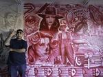 Hispanic artist Angel and a section of his mural near the Barrio Cafe, 16th Street, Phoenix, Arizona