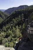 Climbing the basalt walls at the upper end of Oak Creek Canyon, Arizona