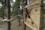 Climbing in the ponderosa pine elevated course at Flagstaff Extreme, Flagstaff, Arizona