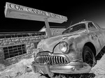 A Buick decays gracefully before the old Cow Canyon Trading Post, Globe, Utah
