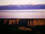 Three Sisters casting shadows at sunrise, shot from Hunts Mesa, Monument Valley, Arizona