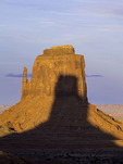 Shadow of the West Mitten falls on the East Mitten, Monument Valley, Arizona