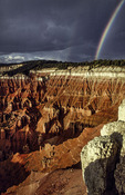 Rainbow over the amphitheater below Point Supreme, 10,300' abover sea level, Cedar Breaks National Monument, Utah