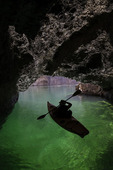 Harry Ford kayaking in Emerald Cave, on the Colorado River in Black Canyon, Arizona