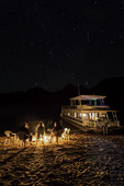 Music under the stars near a 70' Silver Forever houseboat, in Oak Canyon, Lake Powell, Utah