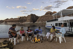 Sunset music near a 70' Silver Forever houseboat, in Oak Canyon, Lake Powell, Utah
