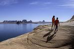 Hiking the slickrock in Padre Bay, Lake Powell, Utah