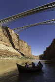 The dory 'Rio Rojo' rows under the Navajo Bridges, Marble Canyon, Arizona