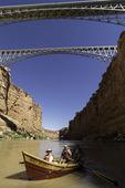The dory 'Rio Rojo' rows under the Navajo Bridges, Marble Canyon, Arizona