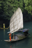 A young woman poses with parasol in the Tribe of the Three Gorges area, Yangtze River, China