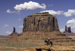 A Navajo rides his horse on John Ford Point, Monument Valley, Arizona