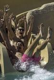 Friends go water sliding at Sheraton Wild Horse Pass Resort, Phoenix, Arizona