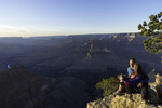 A couple watches sunset from Hopi Point, Grand Canyon National Park, Arizona