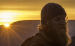 Lucas watches sunrise from Yavapai Point, Grand Canyon National Park, Arizona