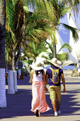 Couple walking by the Malecon, Puerto Vallarta, Mexico