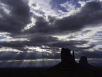 Stormy morning sky over the Mittens, Monument Valley, Arizona