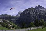 Tandem paragliding above Murren, Eiger in background, Bernese Oberland, Switzerland