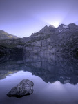 Sunrise over the Bluemlisalphorn, reflected in Oeschinensee, above Kandersteg, Switzerland