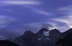 Stars and clouds over the Bluemlisalphorn, above Oeschinensee, near Kandersteg, Switzerland