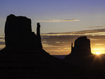 Autumn sunrise behind the Mittens, Monument Valley, Arizona