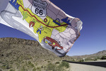A Route 66 flag waves over the Mother Road at Cool Springs, Arizona