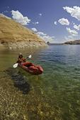 Kayaking below Cookie Jar Butte in Padre Bay, Lake Powell, Utah