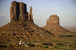 Tourists chill by the Mittens, Monument Valley, Arizona