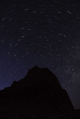 Stars swirl over the Temple of the Sun, Cathedral Valley, Capitol Reef National Park, Utah