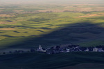 Agrarian wonderland of contoured wheat fields, with Steptoe Butte shadow, in the Palouse of eastern Washington