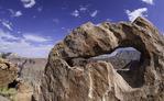 A small arch frames the South Rim near Toroweap, North Rim, Grand Canyon National Park, Arizona