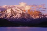 Sunrise illuminates the Torres del Paine over Laguna Amarga, Patagonia, Chile