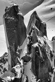 Climbing a granite spire near The Needle at the Midi, 12,600' on Mont Blanc, Chamonix, France
