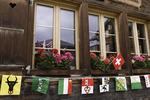 Flags displayed on the main street of Murren, Bernese Oberland, Switzerland